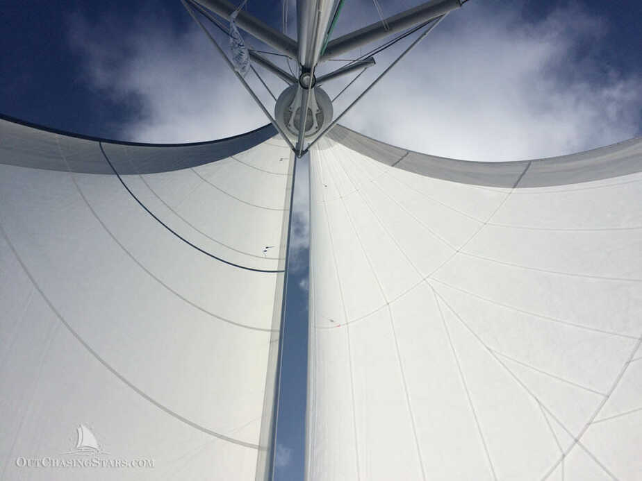 Downwind sailing with dual headsails set to wing and wing.