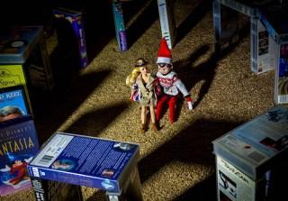 Elf on the Shelf at stonehendge with Barbie