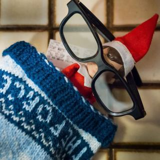 Elf on the shelf in 3D glasses with force awakens ticket