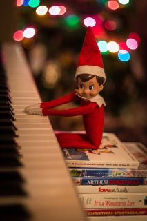 Elf on the shelf uses movies to boost himself to play the Piano