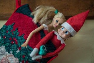 Elf on the Shelf steals a kiss from Barbie