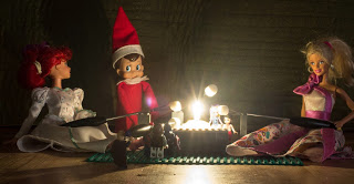 Elf on the shelf with Barbie roasting marshmallows