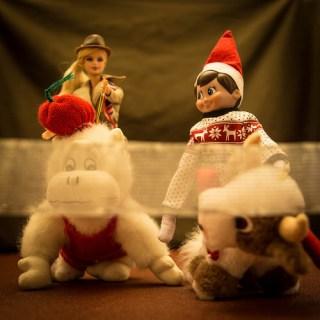 Elf on the shelf riding stuffed animal with barbie