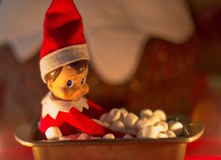 Elf on the shelf takes a bath in marshmallows