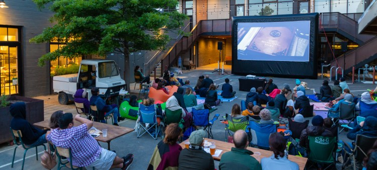 Outdoor movie night at Forage Kitchen's cool outdoor space with preferred AV vendor FunFlicks in Oakland California