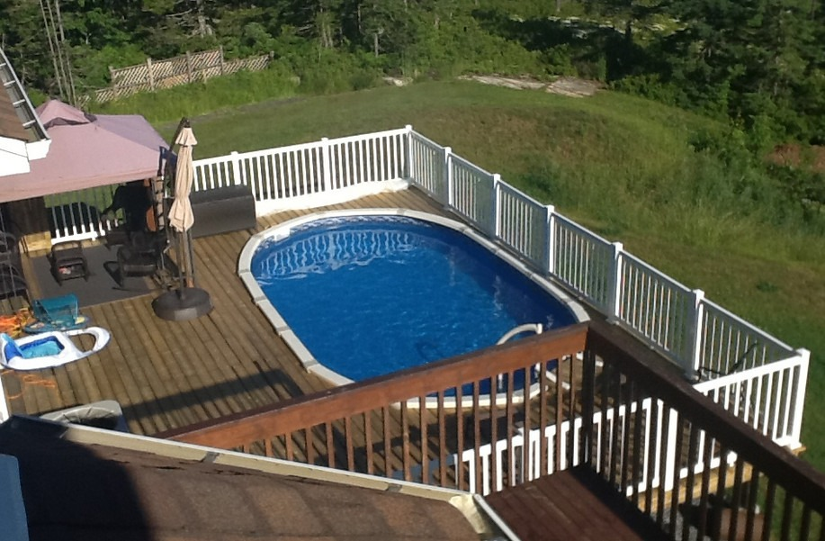 This Raised Above Ground Pool Build Actually Looks As If It Flows From The  First Floor Of The House. The Wide Decking Area Allows For Entertaining And  Fun, ...