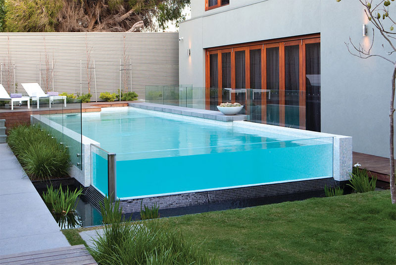 This Above Ground Swimming Pool Uses A Beautiful Glass Edge That Looks  Extremely Stylish. The Small Decking To The Rear Acts As A Small  Entertaining Area ...