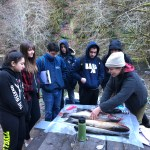 Students learning about salmon biology with salmon carcass