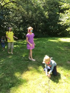 Children following a rope while blindfolded