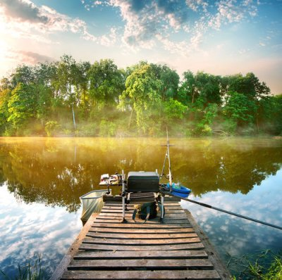 fishing a calm river in the morning on a dock