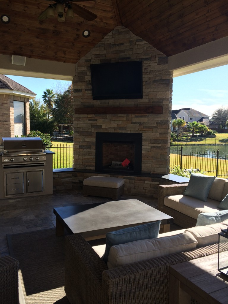 Houston Patio A Stylish Addition to Waterfront Home on Covered Outdoor Kitchen With Fireplace id=18164