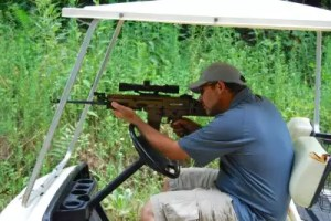 Here's some practical advice: Always keep one hand on the wheel while shooting a tactical rifle from a golf cart.