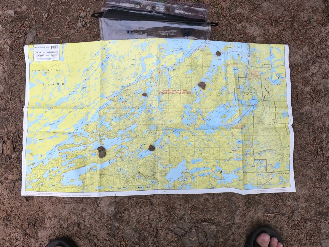 Marking the map on the trail with stones
