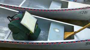 Pack in Canoe with Map and Paddle