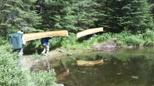 Two Canoe Portage In BWCA