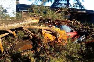 Debris buries a car in Elizabeth City. (Jessica Weatherly)