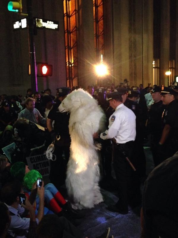 Evan Gattis being led away after a party.