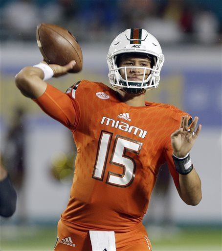 Miami quarterback Brad Kaaya (15) passes against Bethune Cookman in the first half of an NCAA college football game, Saturday, Sept. 5, 2015, in Miami Gardens, Fla. (AP Photo/Alan Diaz)
