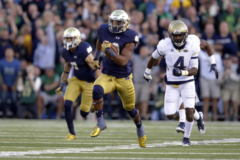 Notre Dame running back C.J. Prosise (20) runs past Georgia Tech defensive back Jamal Golden (4) for a touchdown during the second half of an NCAA college football game in South Bend, Ind., Saturday, Sept. 19, 2015. Notre Dame defeated Georgia Tech 30-22. (AP Photo/Michael Conroy)