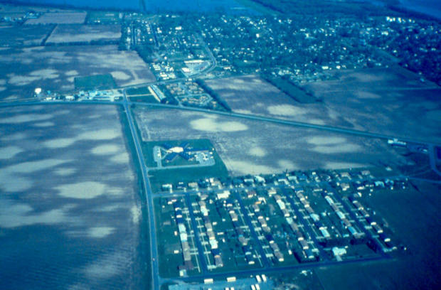 Sandblows (lighter circles) from past seismic activity still dot fields near New Madrid, Missouri. Image provided courtesy of David Rogers and David Stewart.
