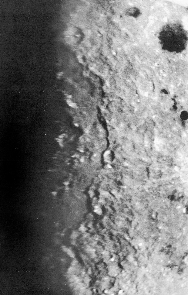 Discovery photo of the Orientale multi-ring basin, 1962.  Only the eastern portion of the ring arcs is visible because the central and western portions of the basin lie on the far side of the moon. Sunlight streams from the right, throwing the far side of the basin into shadow at left.  (University of Arizona, Lunar and Planetary Lab; photo courtesy of William K. Hartmann.)