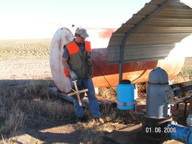 Here, Buchanan is measuring groundwater levels in the Ogallala aquifer in Morton County, Kansas. [Credit: Kansas Geological Survey]