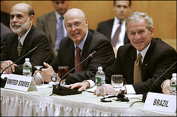 President Bush, right, smiles during the G20 ministerial meeting at the International Monetary Fund Saturday, Oct. 11, 2008 in Washington. From left, Federal Reserve Chairman Ben Bernanke, Treasury Secretary Henry Paulson, and Bush. (AP Photo/Evan Vucci) (Evan Vucci - AP)