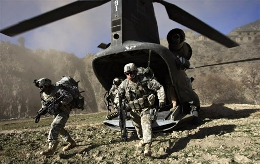 """US soldiers hunt for Taliban and Al-Qaeda militants in Afghanistan's Khost province. President Hamid Karzai has told the UN Security Council that the international community sets a """"timeline"""" for ending military intervention in Afghanistan."""