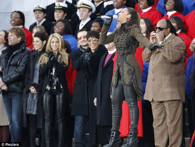 Beyonce Knowles performs America the Beautiful flanked by stars (from left to right) Jon Bon Jovi, Marisa Tomei, Shakira, Bono, Betty LaVette and Stevie Wonder