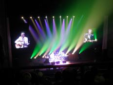 poorly lit, slightly blurry flight of the conchords concert photo