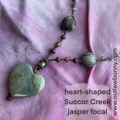 detail of magic necklace with heart-shaped Succor Creek jasper pendant