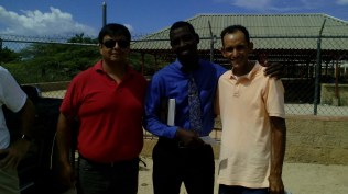 Pastor Jacke Andris in Anse au Pitre, in the center blue shirt. The pastor and missionary Chilean Patricio San Martin right red Polo Shirt, and the pastor and missionary Ruddy Carrera to the right, magenta Polo Shirt.