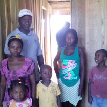 The pastor and his family in their new home.