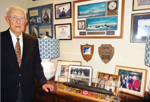"John Watkins created a ""Navy wall"" at his home, a commemoration to his U.S. Navy service that highlights the USS Pasadena SSN-752 submarine."