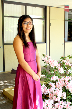 Photo by Merin McDonald / OUTLOOK In addition to a gown for prom, Janelle Bracamontes found this festive fuchsia dress to wear to graduation.