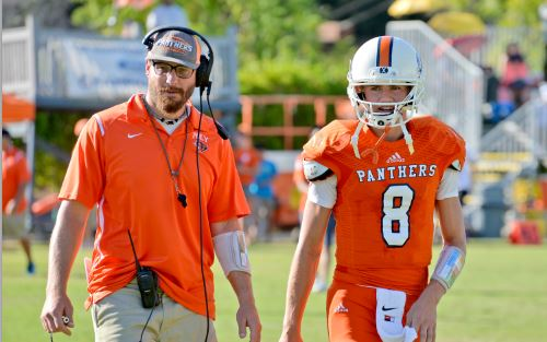 Photo courtesy Jennifer Godwin-Minto Poly Head of School John Bracker said football coach Chris Schmoke, pictured above talking to senior John Genske, is a good mentor to all of his athletes and students.