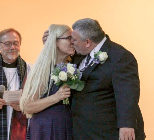 Photo by Staci Moraza / OUTLOOK Rotary Club of San Marino President Denise Wadsworth was married to Richard Blair during last week's club meeting. The Rev. Canon Colville Smythe officiated.