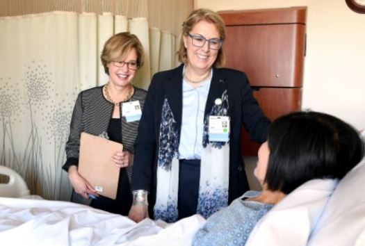 Photo courtesy Huntington Hospital Under the leadership of Huntington Hospital President and CEO Dr. Lori J. Morgan (center), the executive management team makes the rounds weekly to check on patients during their stay at Huntington Hospital. Morgan recently visits a patient with Jane Haderlein, senior vice president of philanthropy and public relations.