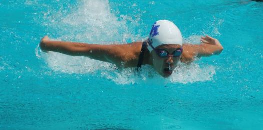 Sophia Yao won the 100-yard breaststroke and helped the Titans win two relay races.