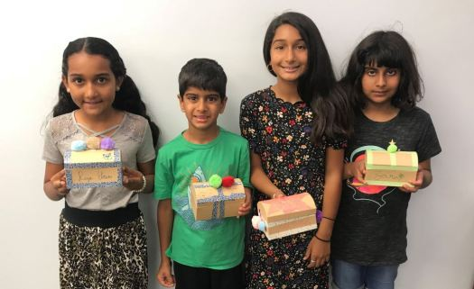 Reya, Zain, Zayna and Zara show off their newly built treasure chests and homes at a recent Kids Creation Station