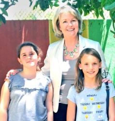 Boys & Girls Club of Pasadena CEO Lisa Cavelier shows off the club's garden at the North Fair Oaks facility with members Paulina Margoosian and Audrey Ponavich.