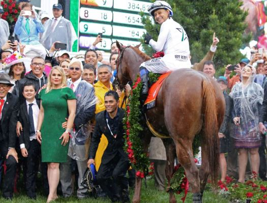 Bob Baffert (left, with sunglasses) celebrating the Kentucky Derby victory of his horse, Justify, at Churchill Downs in May 2018.