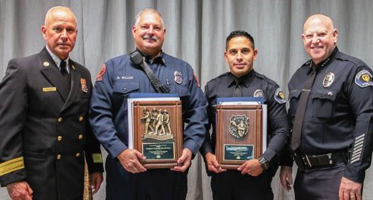 Firefighter-Paramedic Russell Wilcox and Officer Frank Calistro are flanked by their respective chiefs, Mario Rueda and John Incontro, at the San Marino fire and police departments. Wilcox and Calistro were honored by the San Marino Chamber of Commerce last week as the firefighter and police officer of the year.