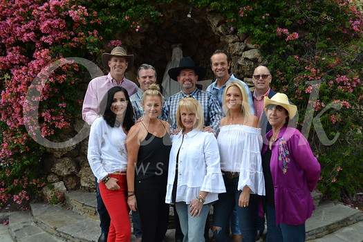 Holy Family Auction Committee members, dressed for the fundraiser's country western theme, include (front row, from left) Jennie McNulty, Andrea Shaffer, Mary Hatton, Diane Vosko and Reparata Mazzola. Back: Chris McNulty, Mark Shaffer, John Hatton, Joe Boskovich and Darrell Done. See additional photos, page X.