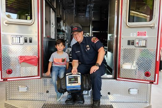 Roland Zeitlin and firefighter paramedic Kirk Batterson