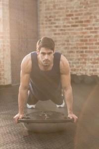 Man doing bosu push ups at gym