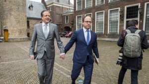 Dutch men hold hands to protest against gay attack