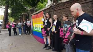 Amnesty hands petition against anti-gay atrocities to the Russian Embassy in London