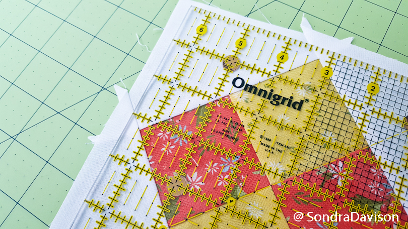 trimming up a quilt block with a square ruler