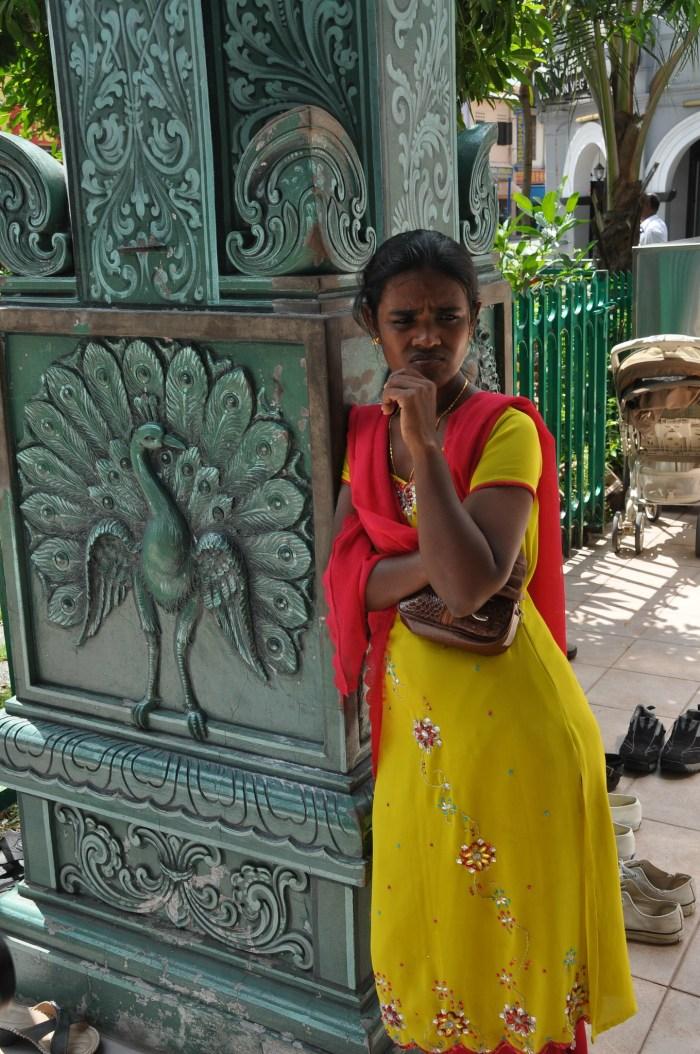 Lady outside Sri Veeramakalimman Temple